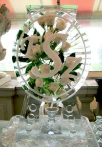 Oval Monogram luge with fresh white roses