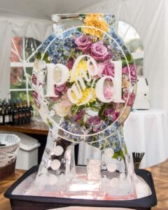 Drink luge with fresh flowers to match brides bouquet.