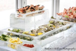 Our Standard Raw Bar close up. The ice server with the crab claws in it can be substituted for a logo or sculpture of your choice