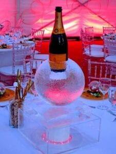 Sphere ice sculpture to hold bottle