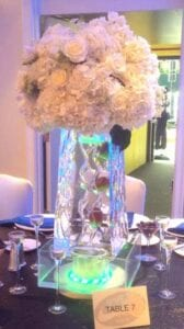 Tall vase centerpiece with flowers Ice Sculpture