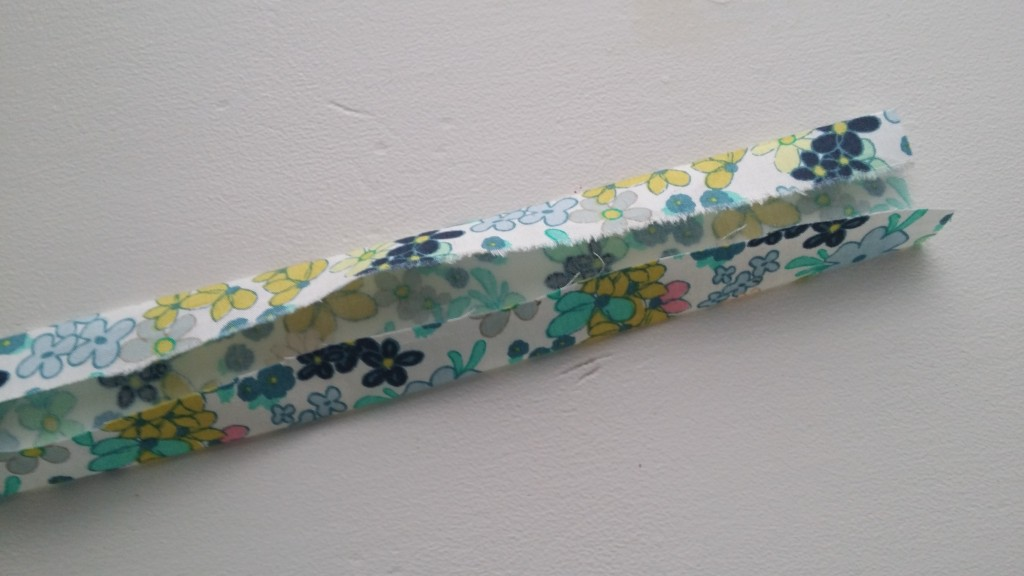 Make your binding by folding down the two ends towards the middle