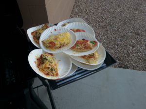 Several finished pizzas
