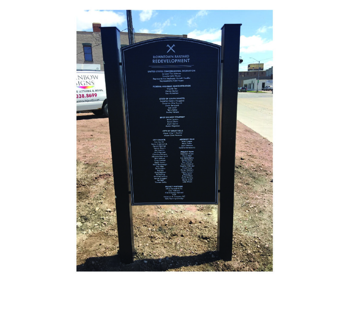 Custom bronze plaque with raised letters. Custom metal signposts.