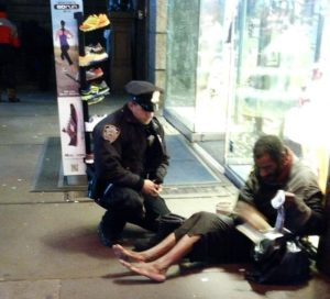 New York City officer buys a homeless man a pair of boots