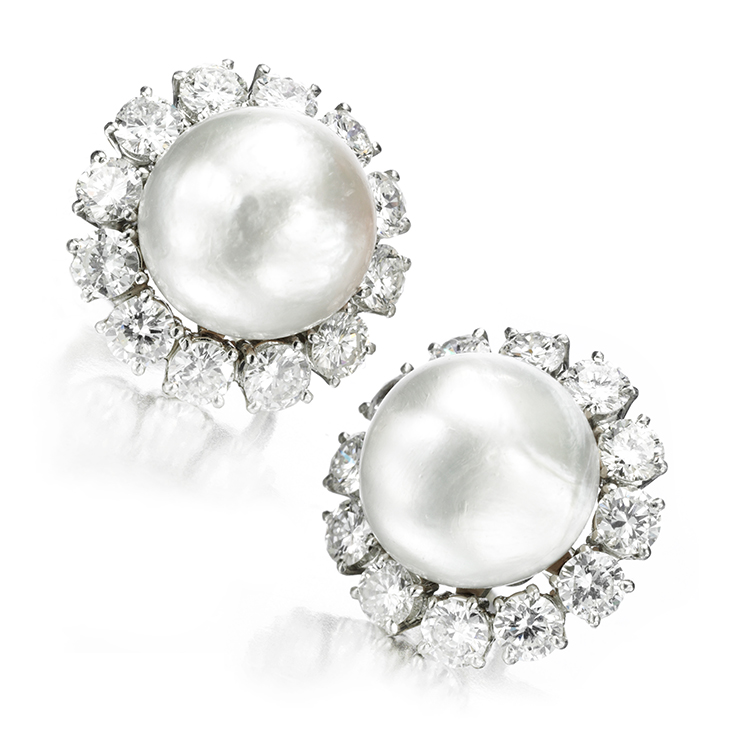 A Pair of Natural Pearl and Diamond Ear Clips, measuring approximately 12mm