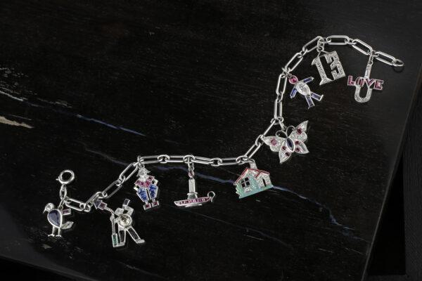 Cartier Art Deco Platinum And Gem-set Charm Bracelet