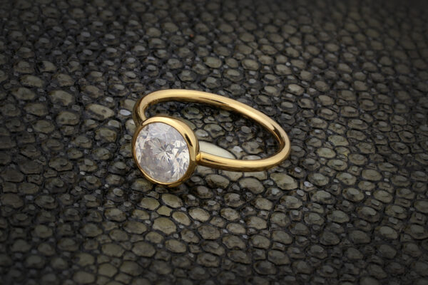 A Round Milky Diamond And Gold Ring