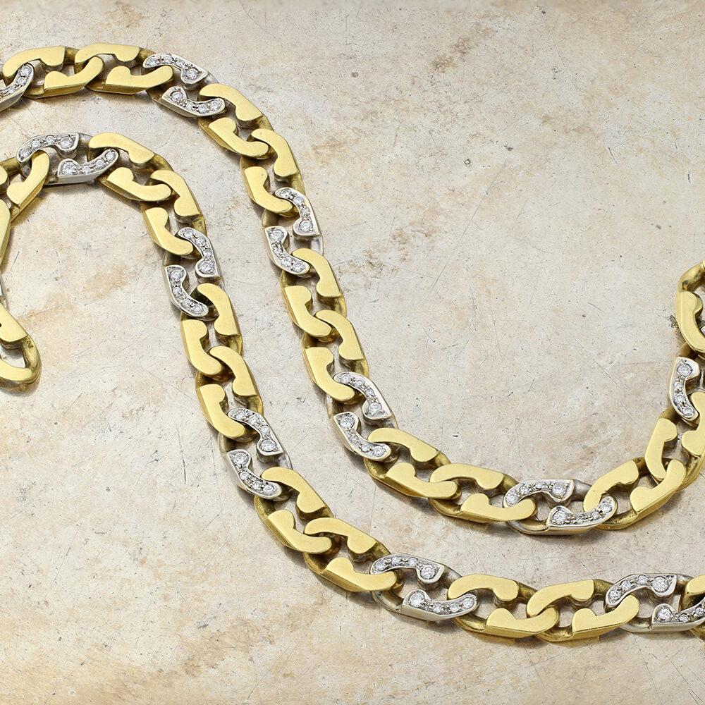 A Pair of Cartier Diamond Set Gold Bracelets