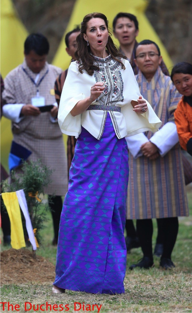 kate middleton reacts throws dart bhutan