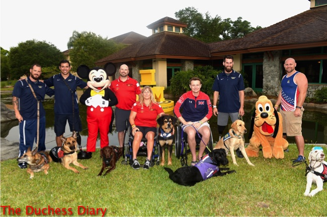 service dogs invictus games pose mickey mouse pluto owners