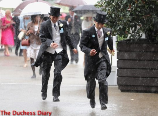 two racegoers morning suits top hats run for cover rain royal ascot day one