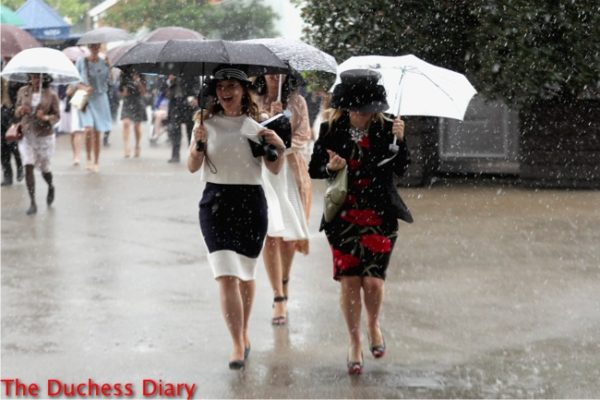 ladies laugh run for cover umbrellas royal ascot day one