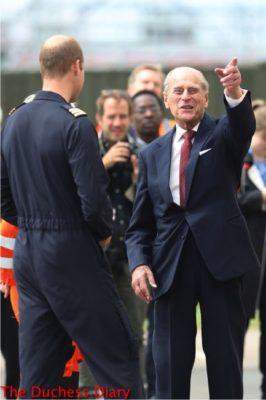 prince philip laughs points prince william joking cambridge airport