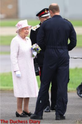 queen smiles prince william east anglia air ambulance base