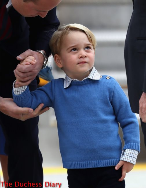 prince george blue sweater looks up victoria airport canada