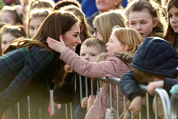 Little Girl Pink Coat Strokes Kate Middleton Hair