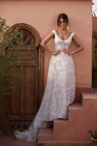 ASPEN-ML17911-FULL-LENGTH-LACE-GOWN-WITH-FITTED-BODICE-AND-FLOATY-SKIRT-CAP-SLEEVES-LOW-BACK-ZIP-CLOSURE-WEDDING-DRESS-MADI-LANE-BRIDAL5