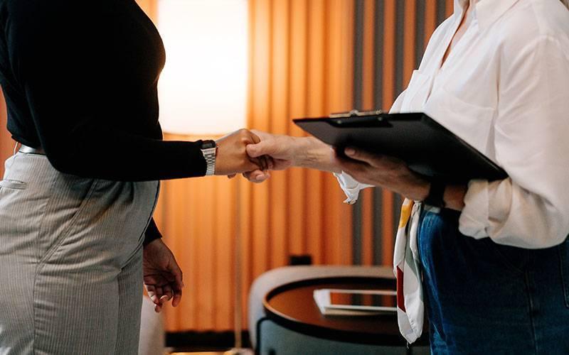 Employee shake hands
