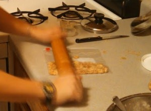 Moving so quickly her hands blurred, A crushes the peanuts with her rolling pin of might.
