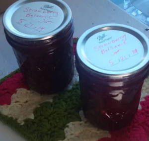 Two jars of jam on a potholder