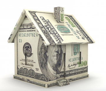 This is an illustration of dollar bills folded into the shape of a house. It is to illustrate Michael Edlen's article about the upcoming tax initiatives.