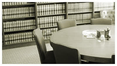 round table in a law library, representing general liability defense