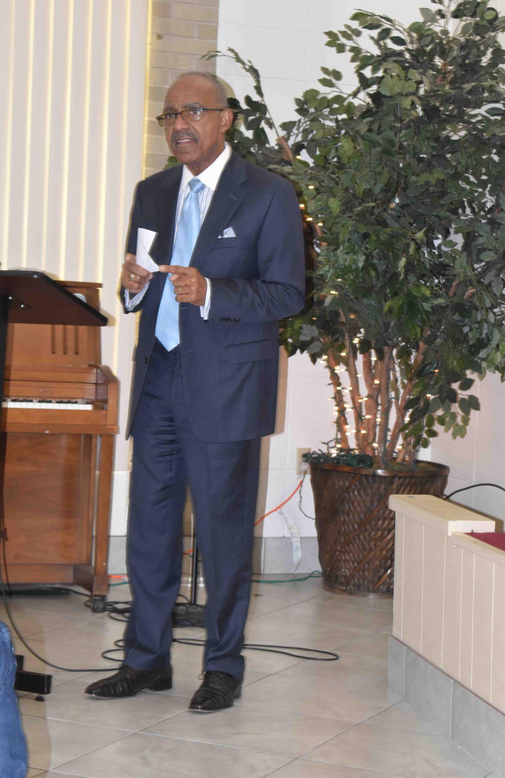Rev. Truman Tolefree address attendees