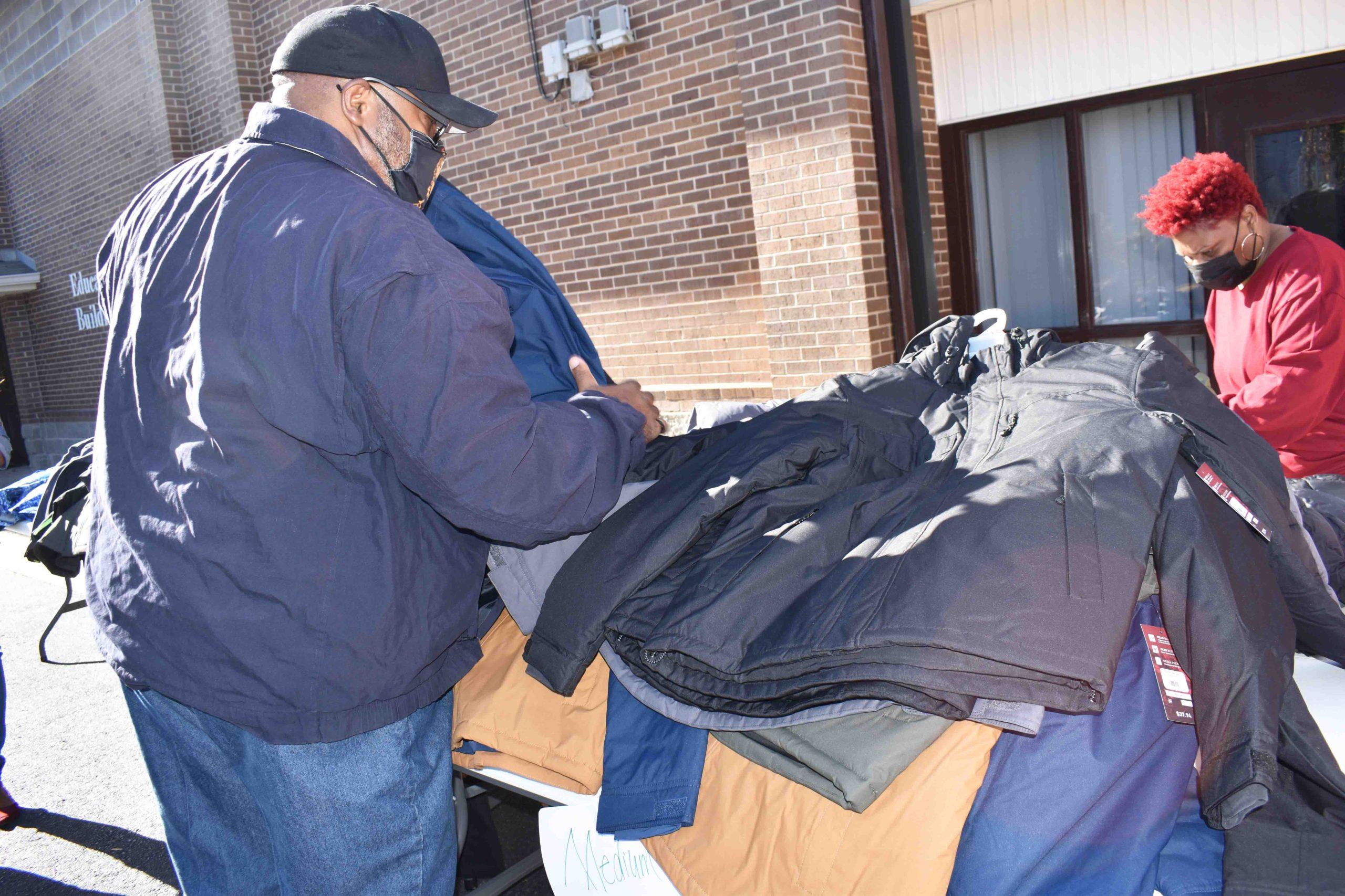 Volunteers sort coats