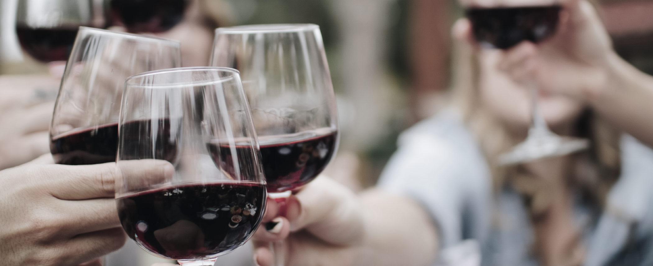 group of people enjoying red wine