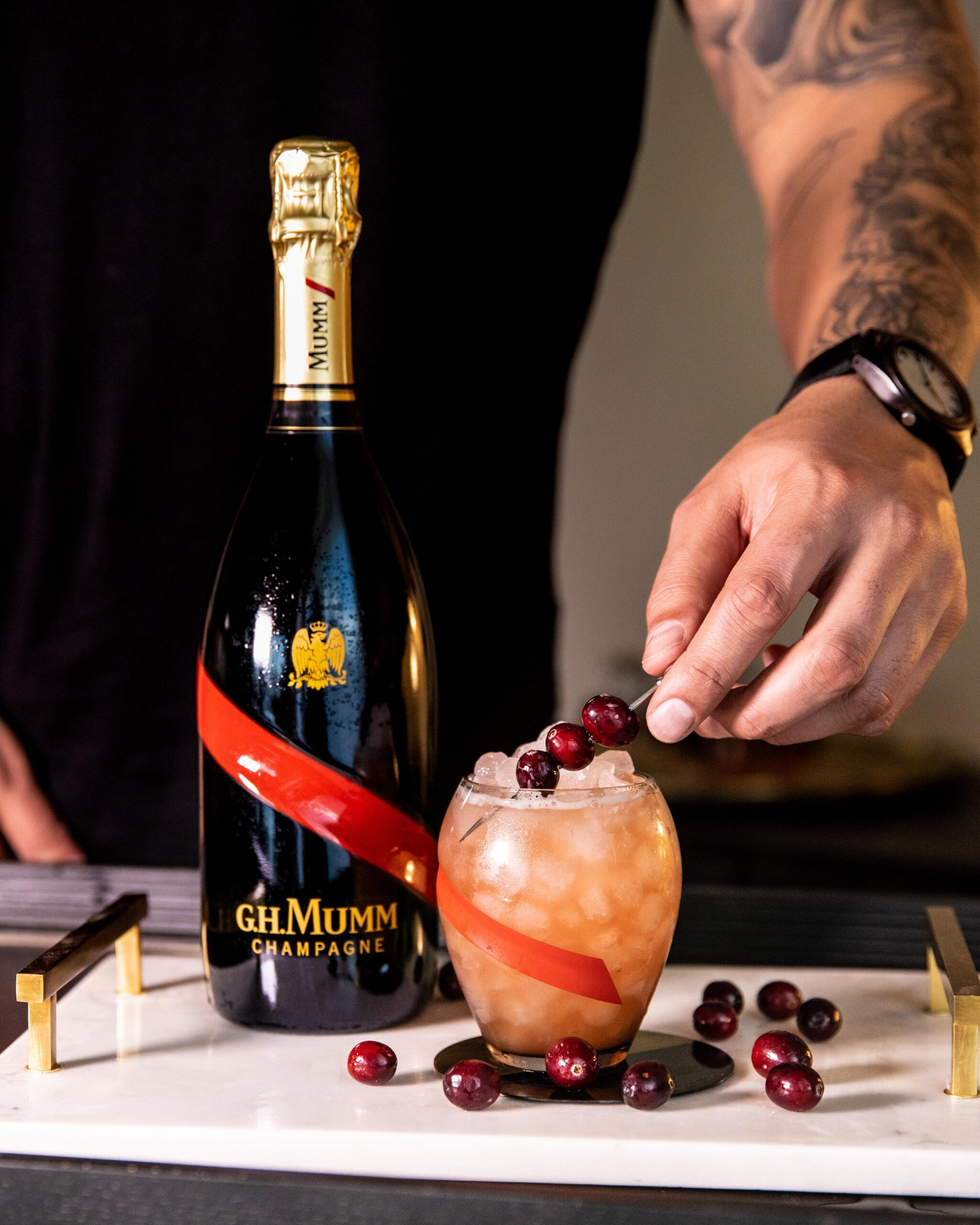 Cranberry Scotch Champagne cocktail with GH Mumm Brut