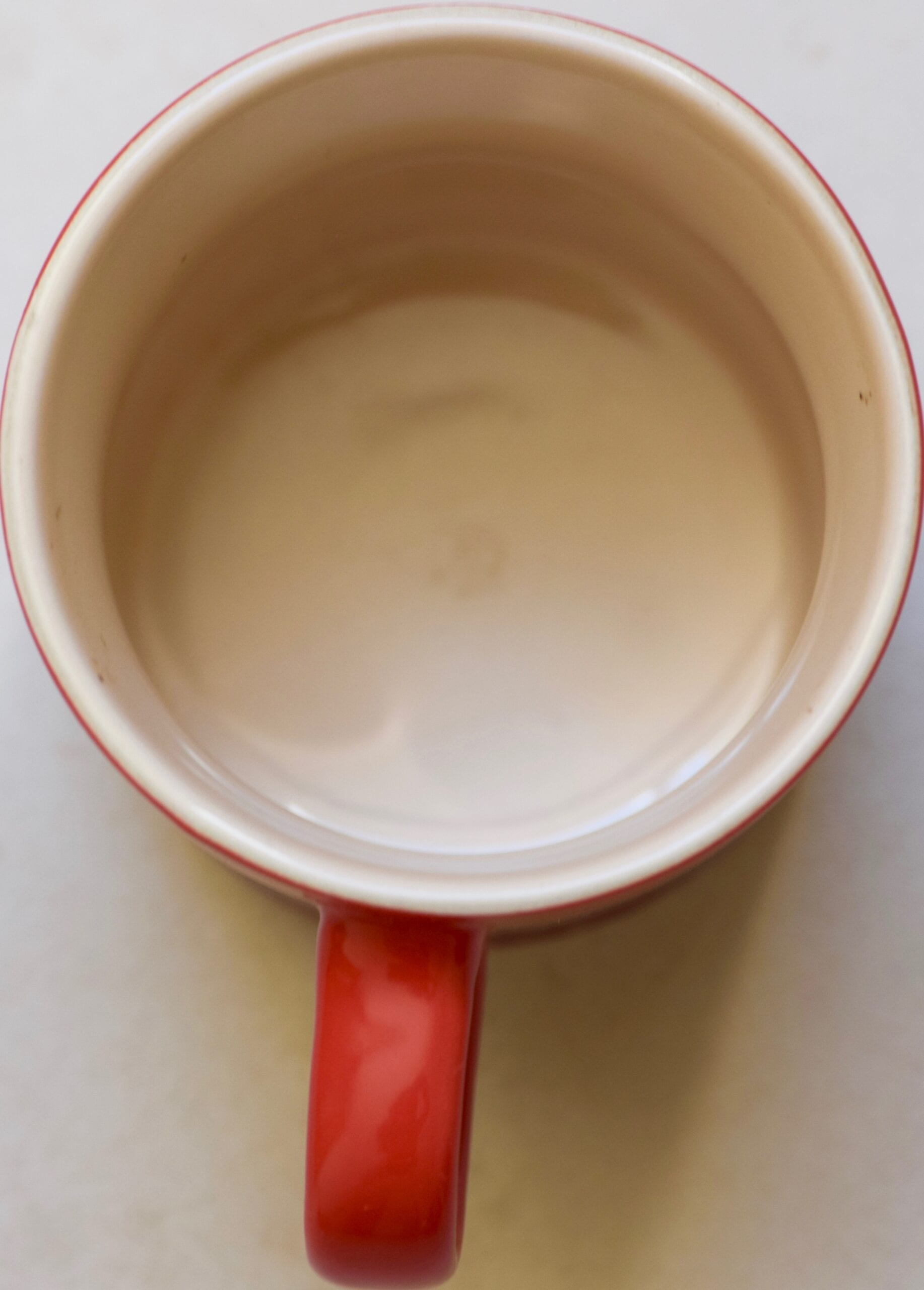 Greased mug with oil spray