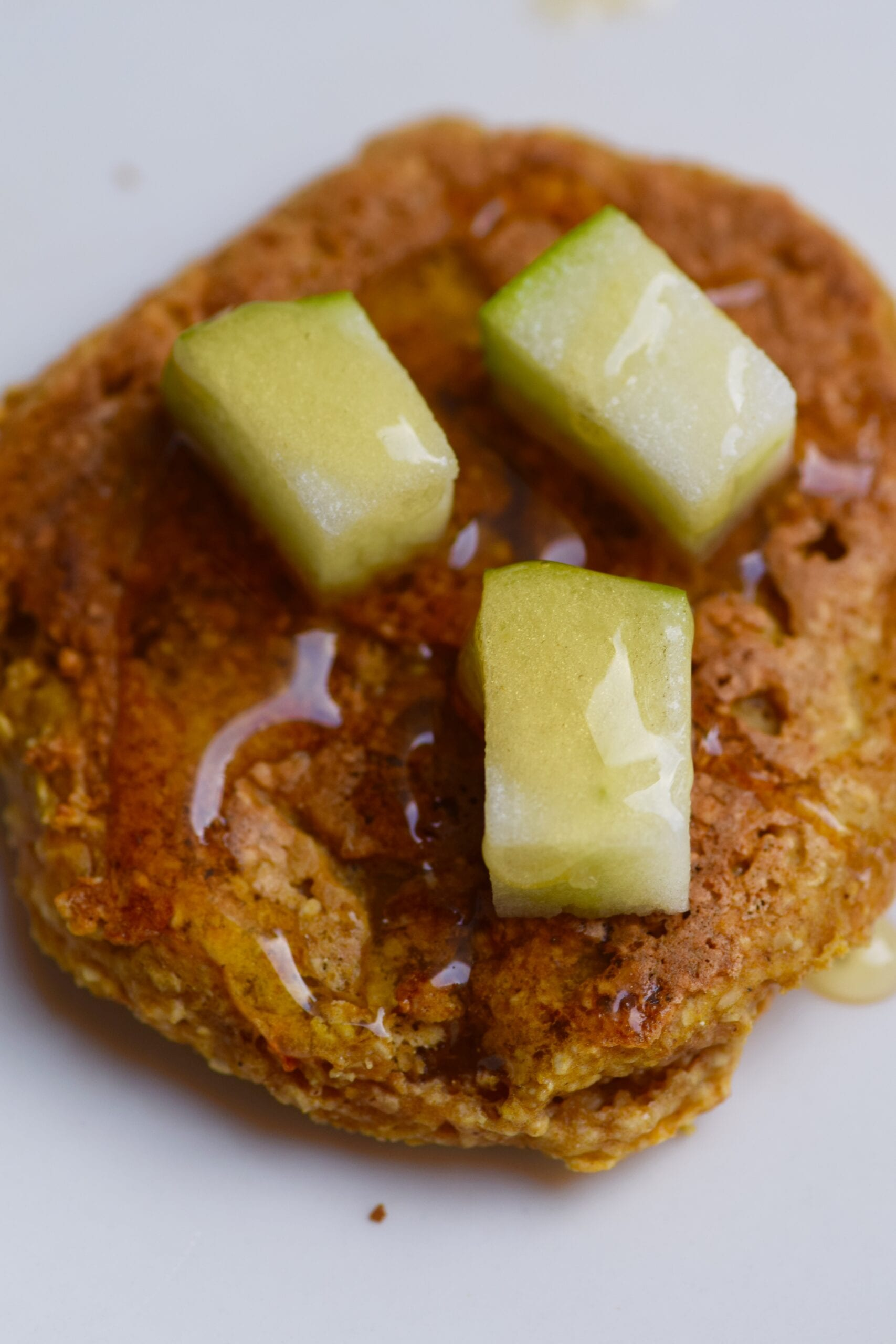 Pumpkin pancakes topped with apples and honey