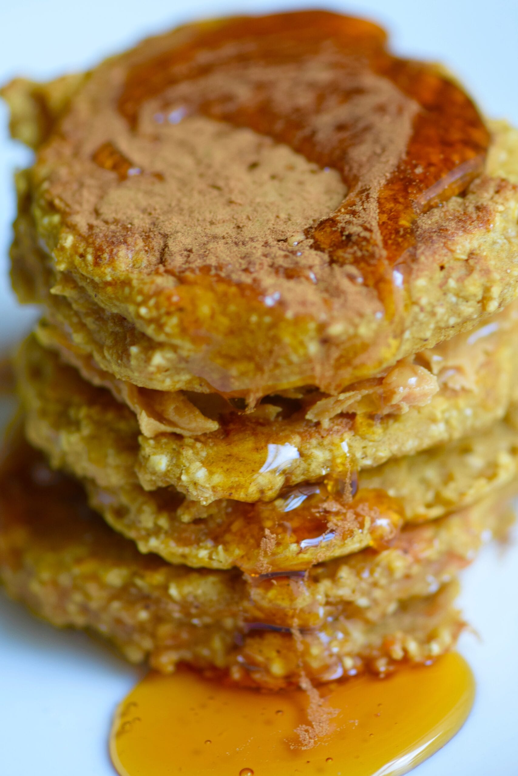 pumpkin pancake stack with syrup drizzled on-top