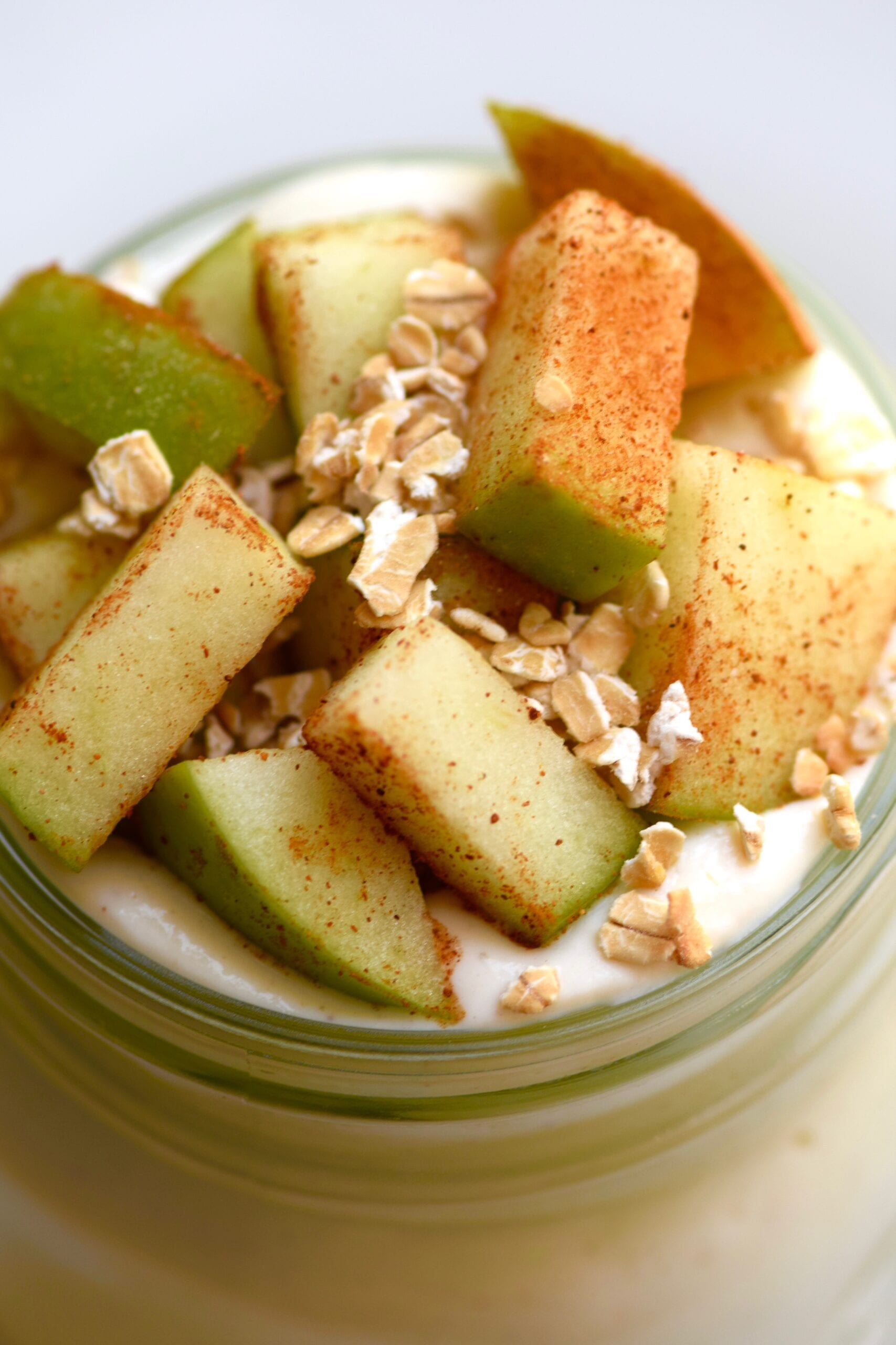 healthy apple pie cheesecake with chopped apples and granola topping