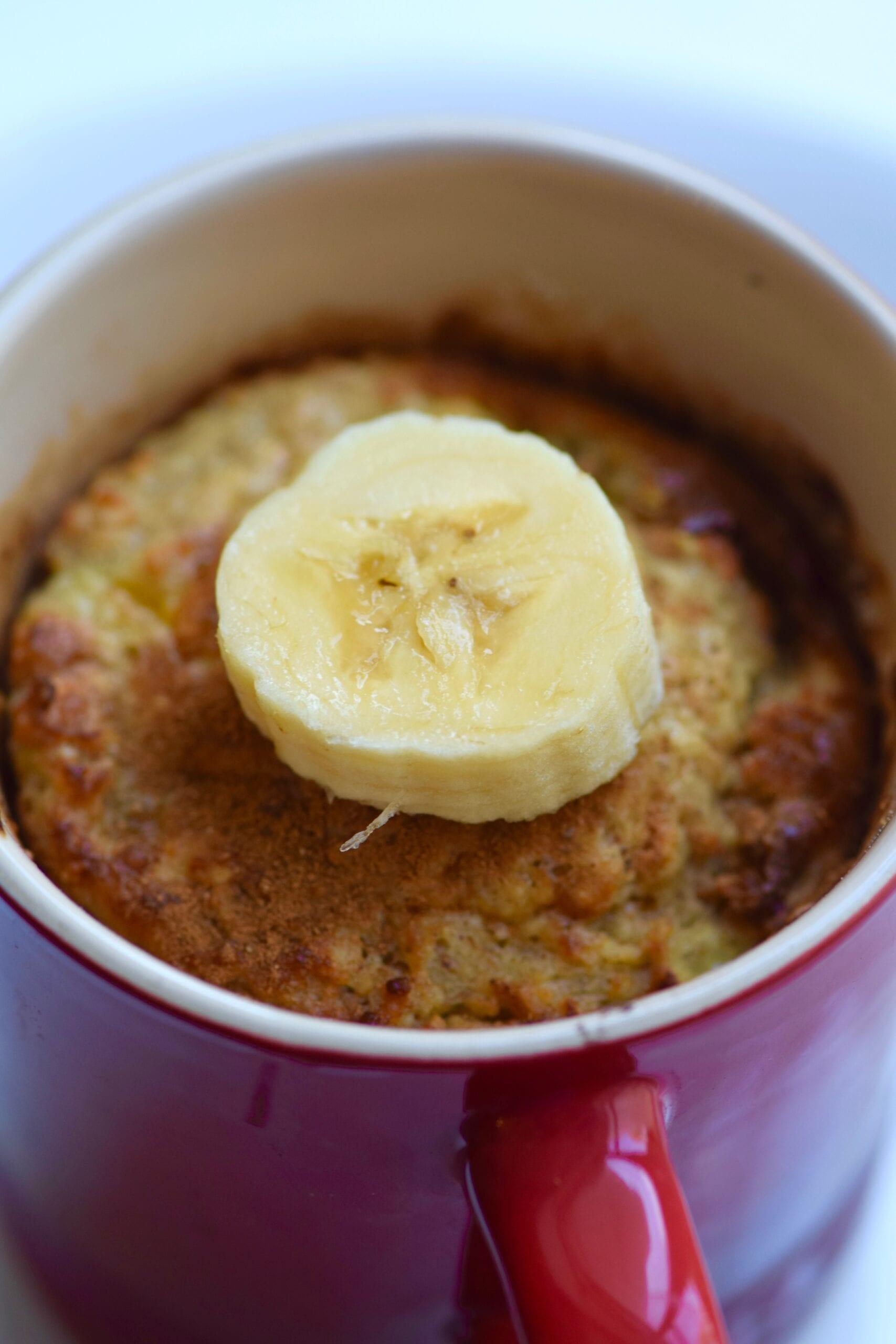 Healthy banana mug cake with fresh bananas