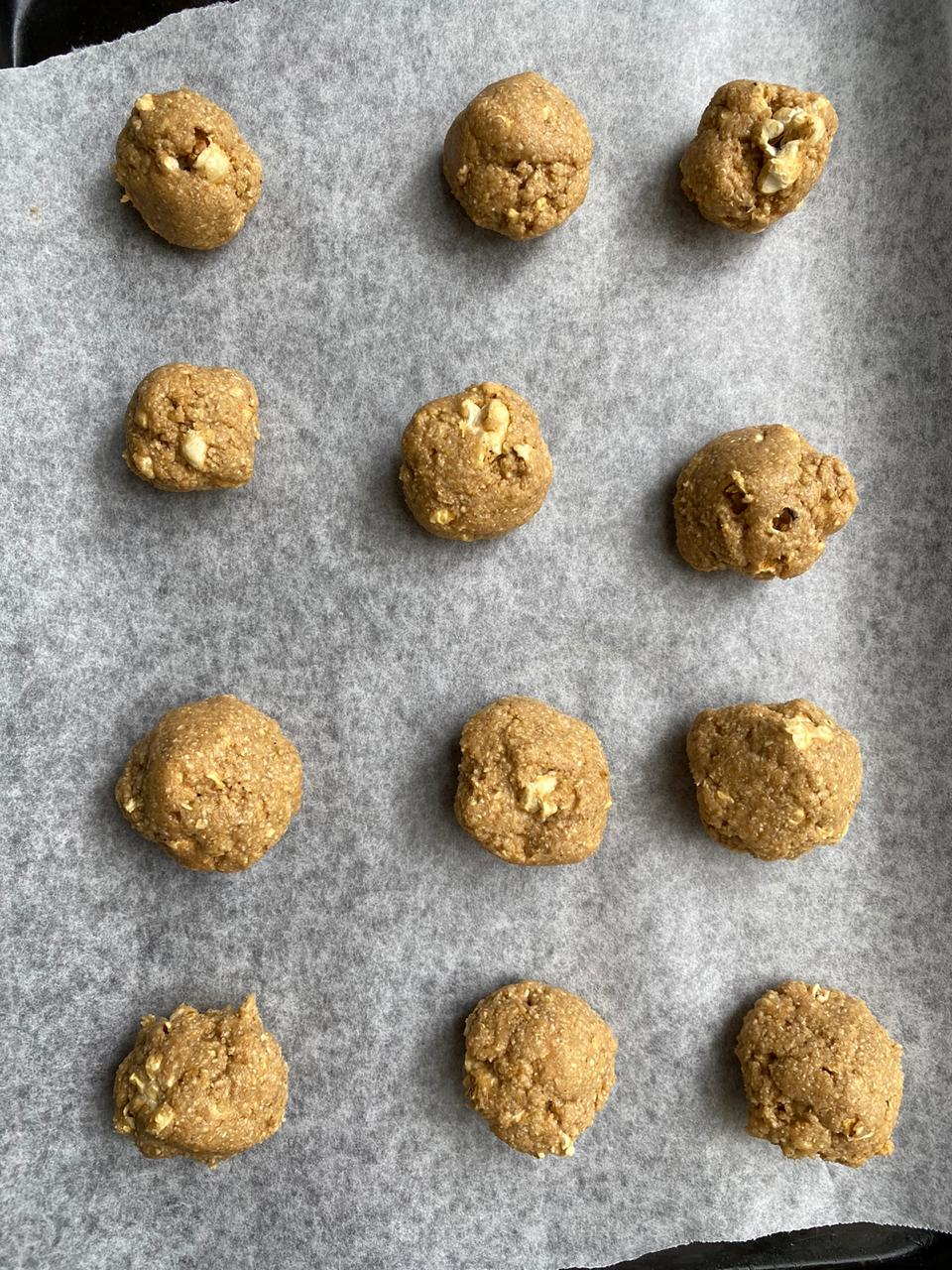 rolling the cookie dough into balls