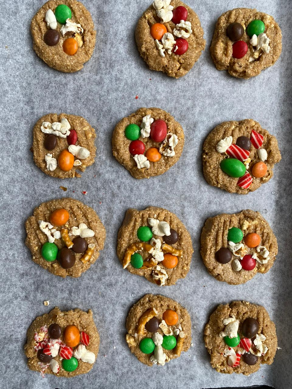 adding toppings to the easy christmas cookies