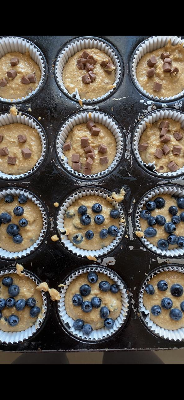 Placing the muffin mixture inside the muffin tins