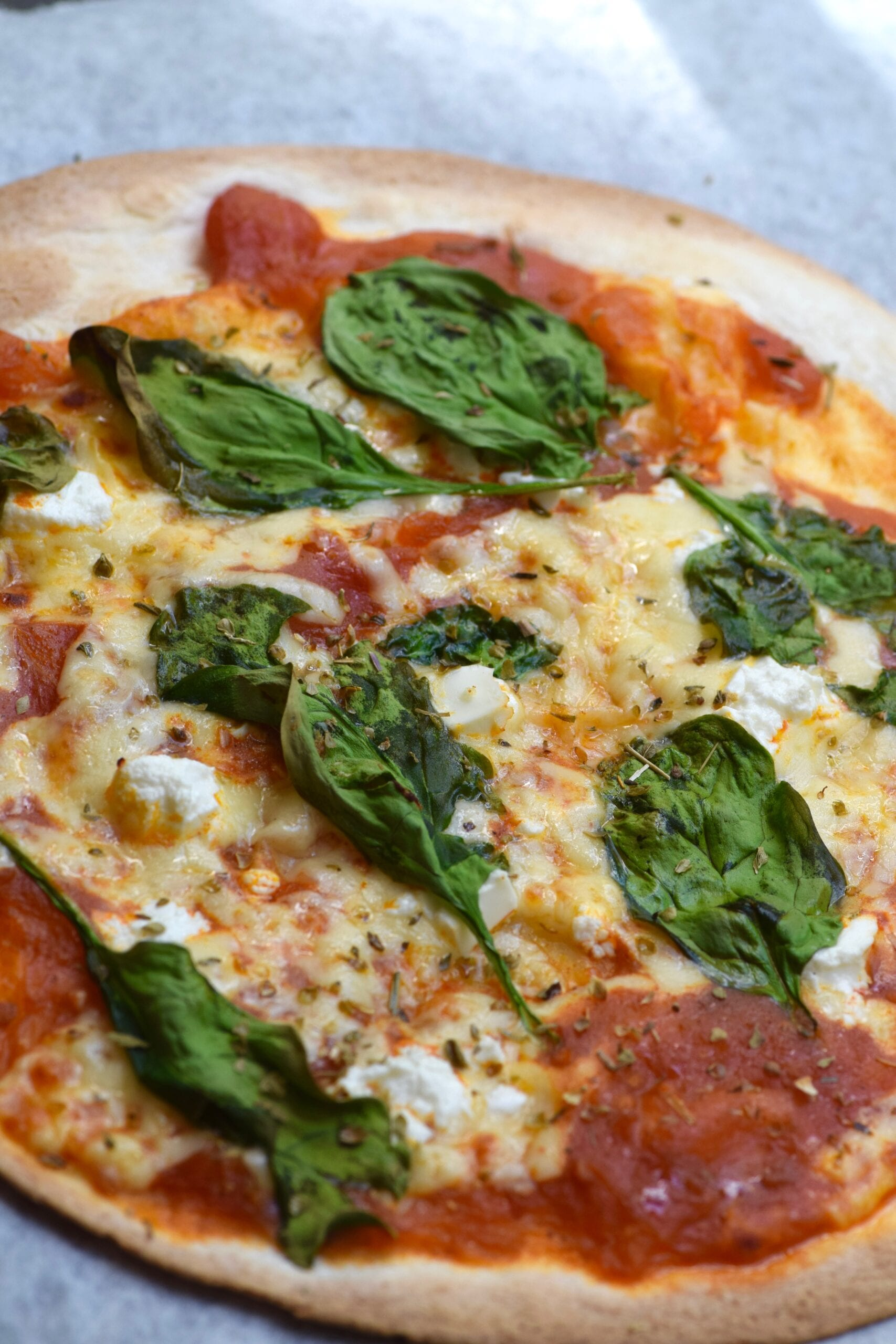 Low calorie spinach and feta pizza straight from the oven