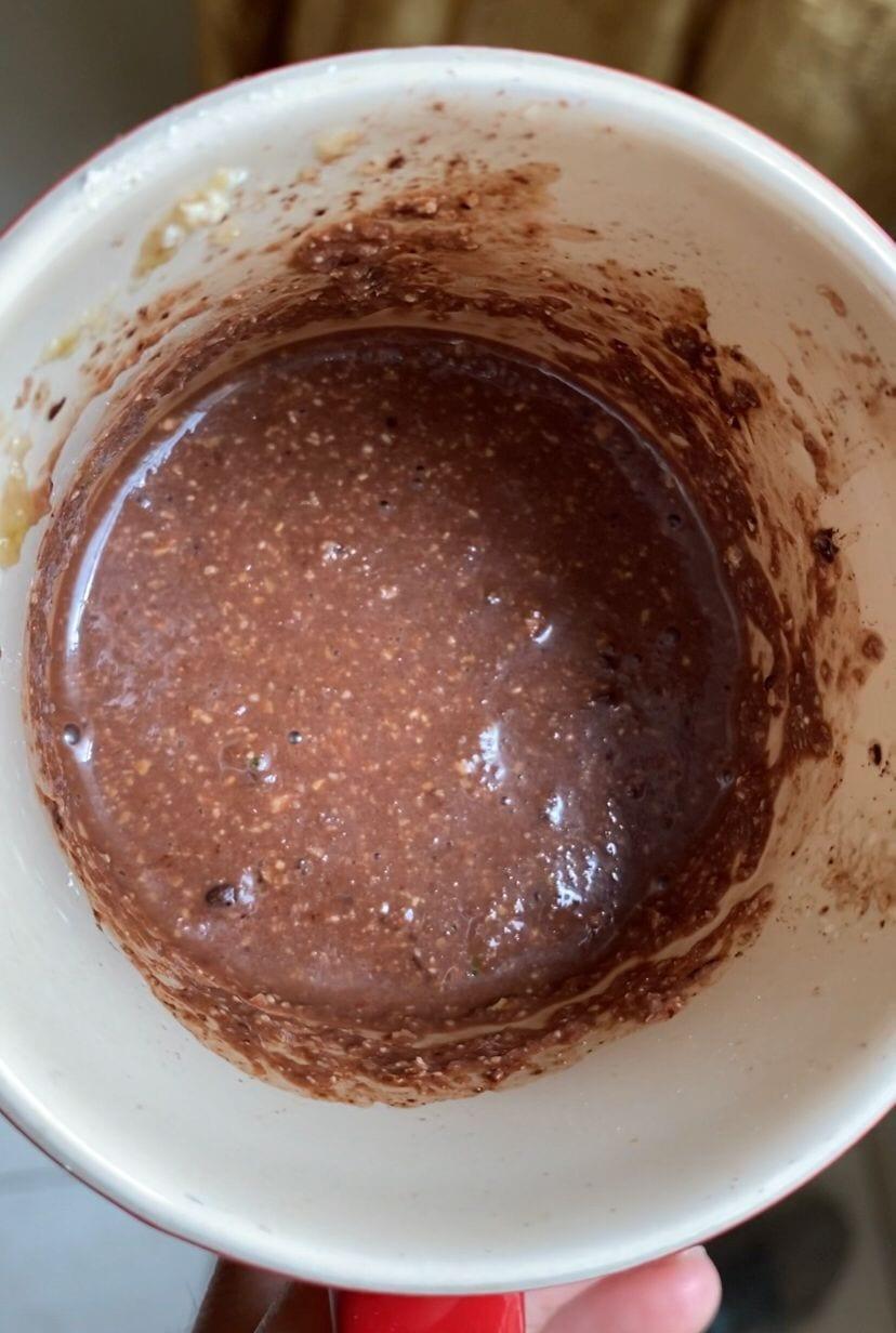 Mixing batter for chocolate zucchini vegan mug cake