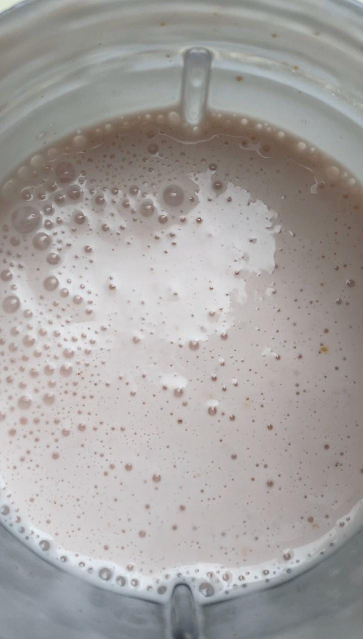 All ingredients blended for the high protein strawberry cheesecake recipe including gelatin