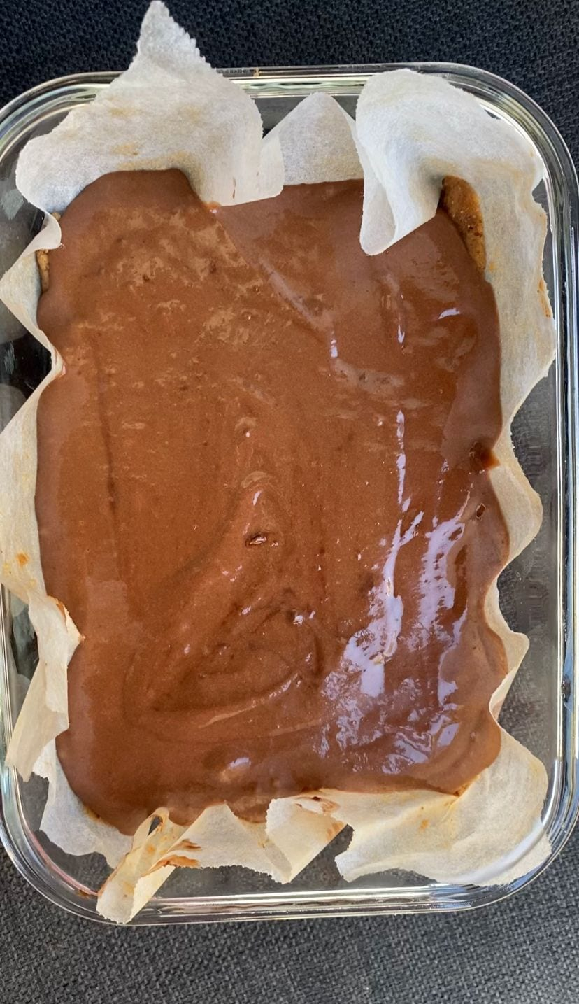 Pouring chocolate mousse mixture into container