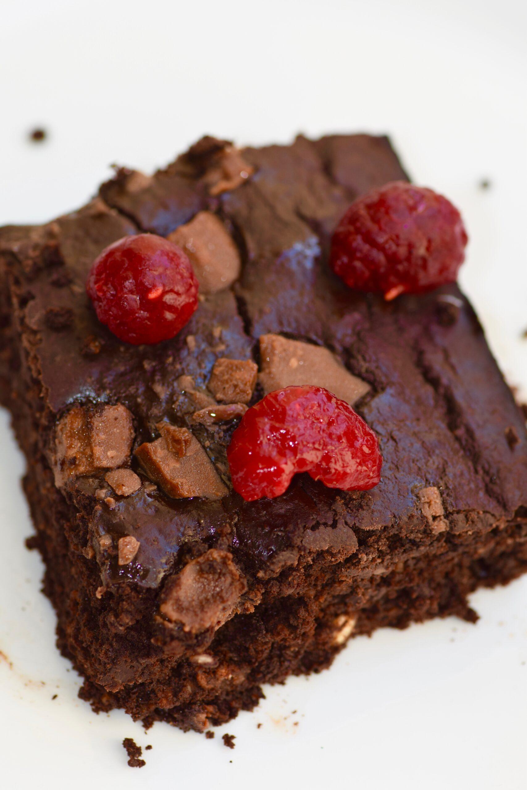 Healthy fudgy pumpkin brownies with raspberries