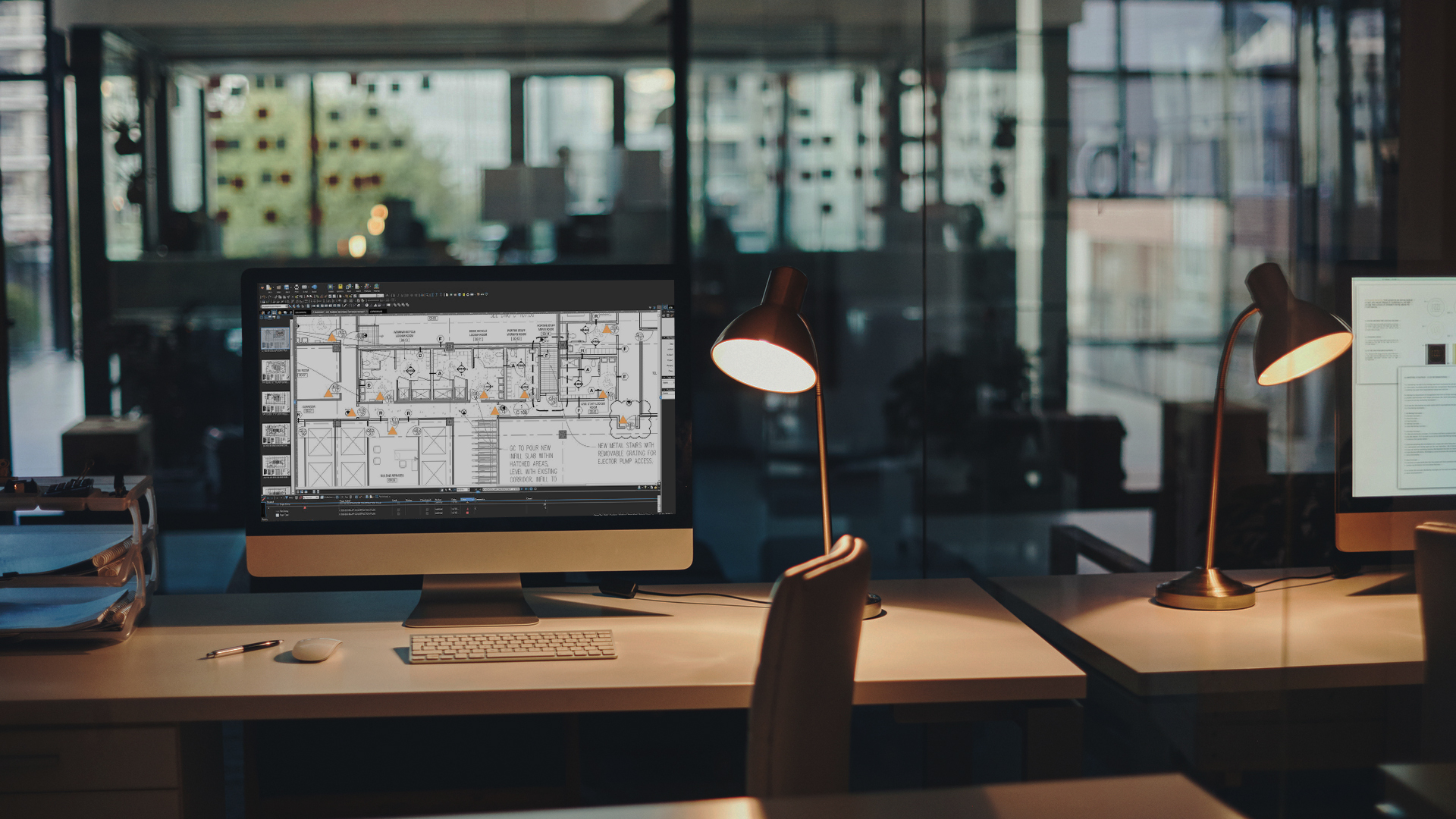 Autocad plans on computer screen in modern office