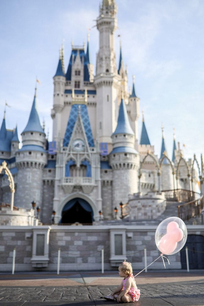 Elodie in front of Cinderella's Castle at Magic Kingdom