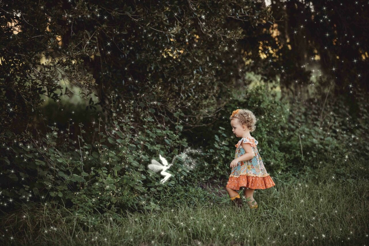 Little Child playing with magic fairy