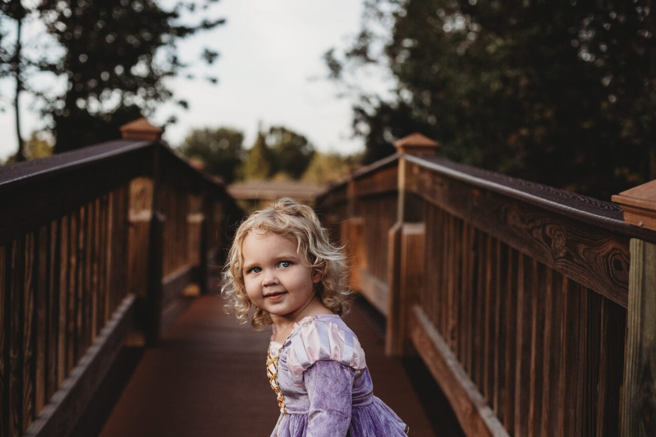 toddler girl on bridge