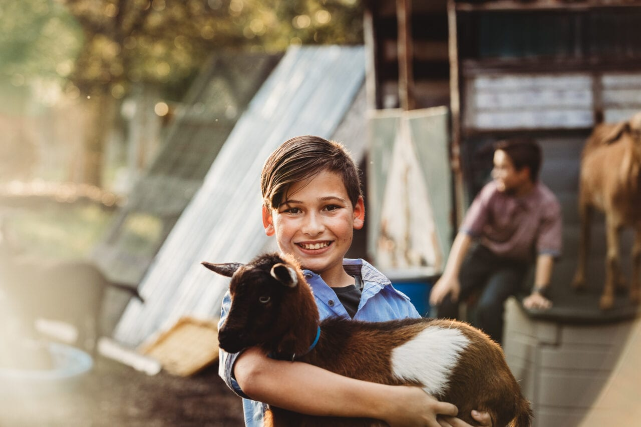 boy with goat on central florida farm
