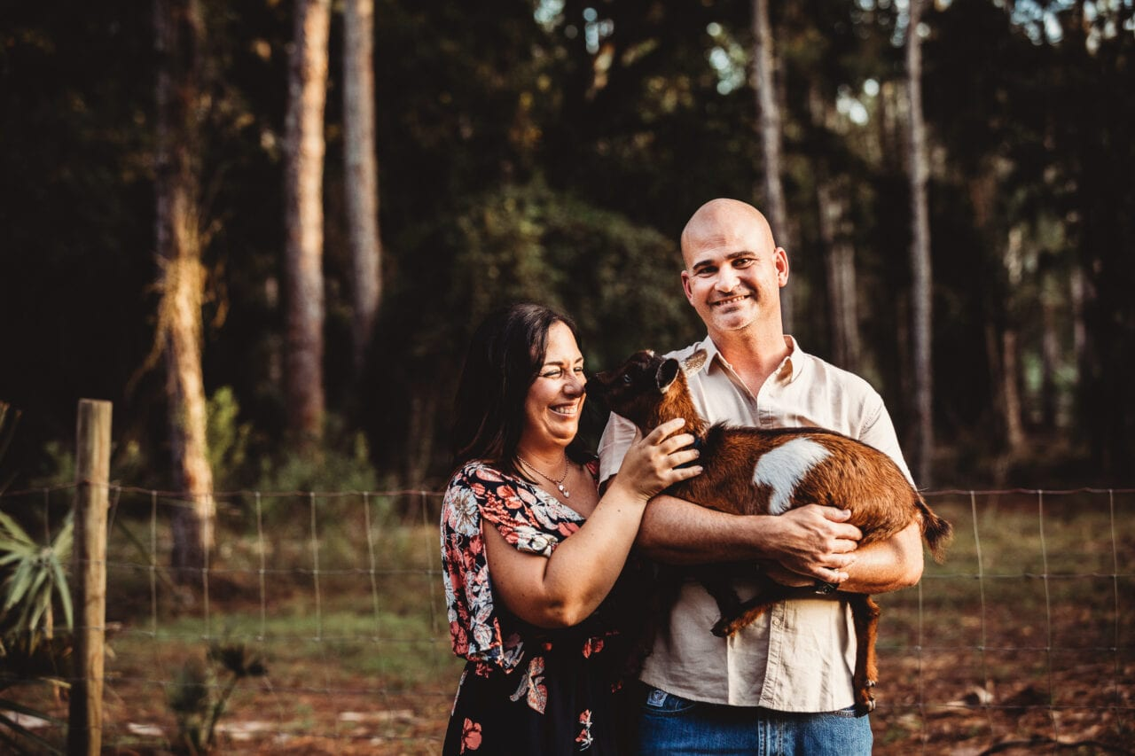 parents with goat on central florida farm